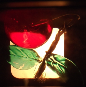 Cherry, moulded & painted glass as seen through 20th C slide viewer