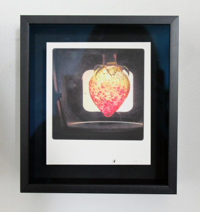 strawberry, circa 1989, handworked and painted glass, broken, as seen through 20th C slide viewer